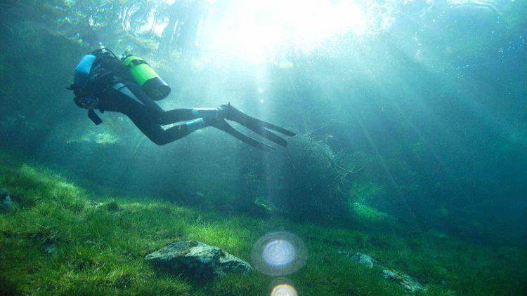 Man scuba diving in freshwater lake in Austria.